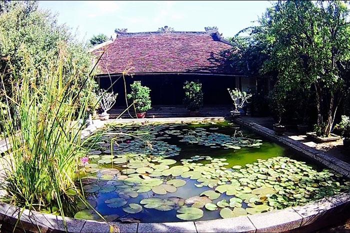 Estanque de la casa jardin An Hien en Hue