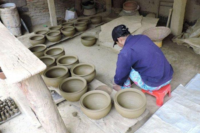 Taller tradicional del pueblo de thanh ha en Hoi An